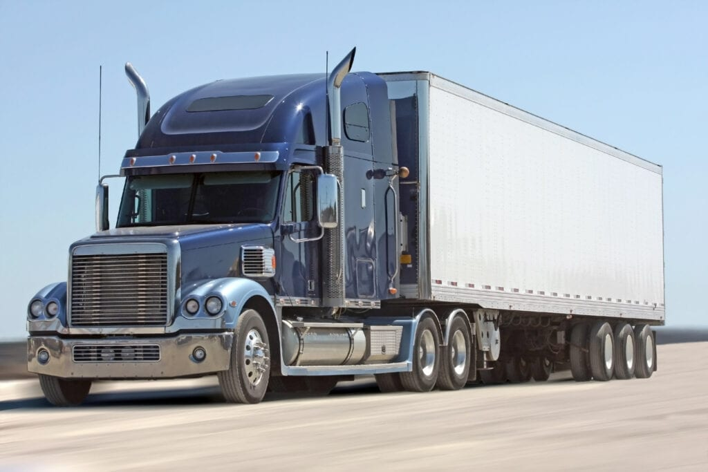 semi tractor trailer truck hauling freight using AMSOIL Synthetic Diesel Oil